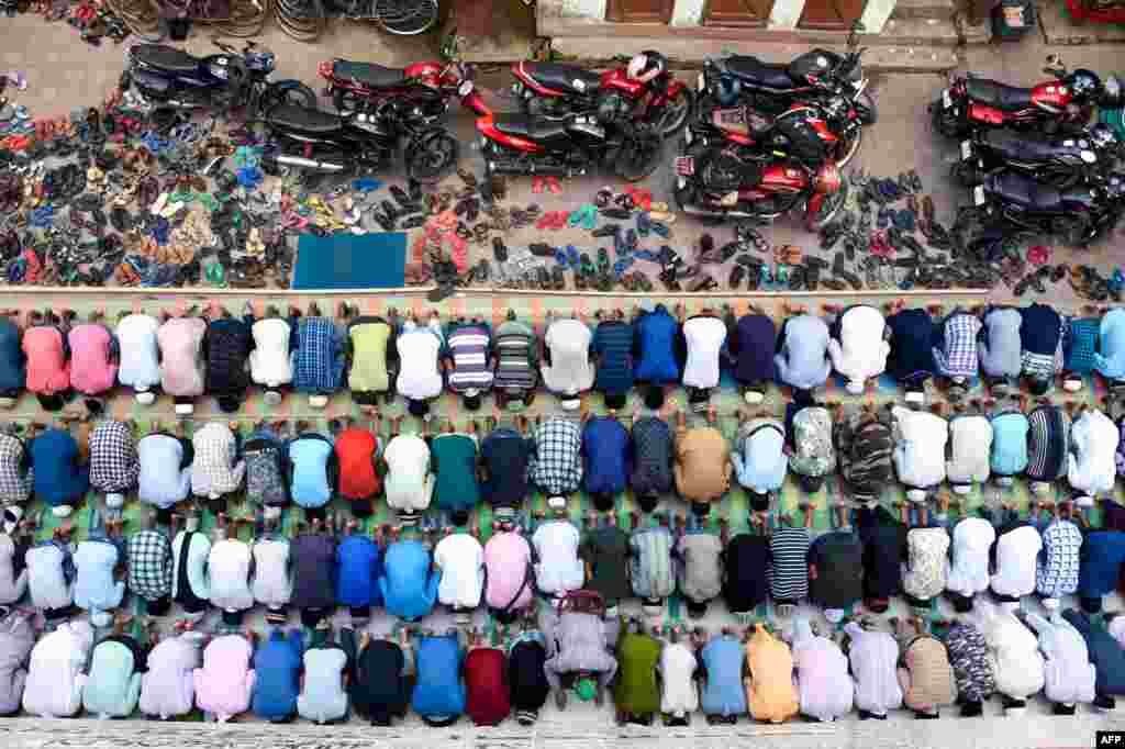 Indian Muslims offer last congregational Friday Prayers for the holy month of Ramadan on a road in Agartala on May 31. (AFP)