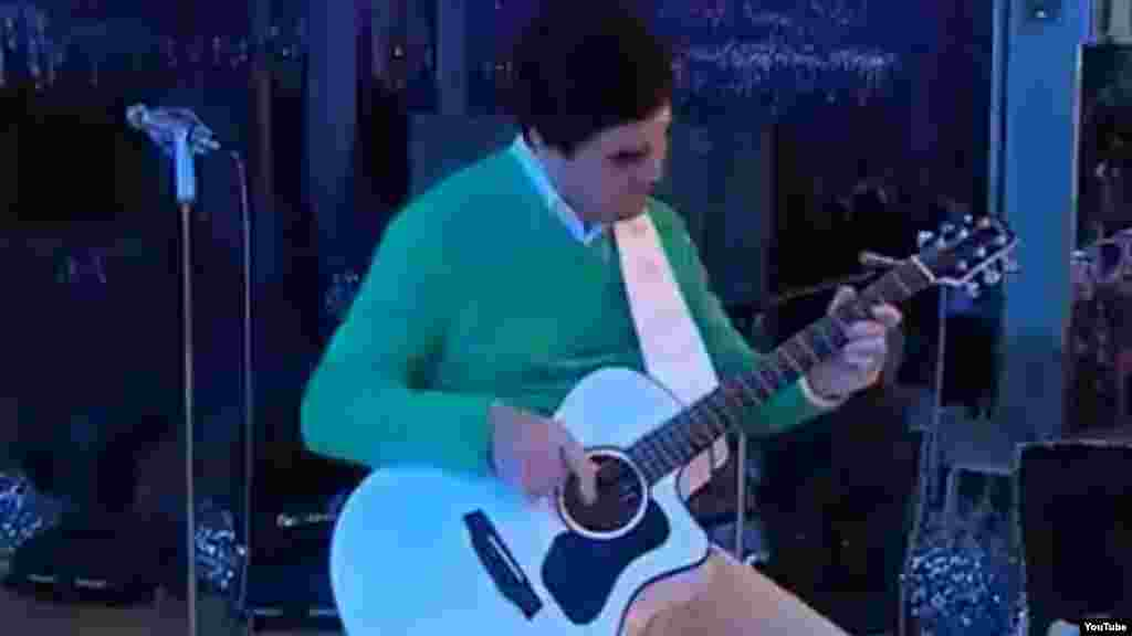 Berdymukhammedov has even performed pop songs in an attempt to build his own personality cult. Here, he plays an all-white guitar for a performance backed by singers dressed in white and playing white instruments.