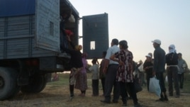 Students being transported in the back of trucks to pick cotton in Uzbekistan's Jizzakh region, 6Sep2012