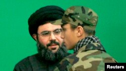 Lebanon -- Jihad Moughniyah (R), son of Lebanon's Hizballah late military leader Imad Moughniyah, greets Sayyed Hashem Safieddine, head of Hizballah's Executive Council, as they attend a ceremony marking a week of his father's death.