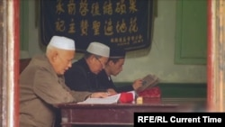 Ethnic Kazakhs pray in a mosque in the Chinese Xinjiang Uyghur Autonomous Region.