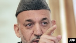 "Afghan President Hamid Karzai: ""We're grateful even for the little money that's come to Afghanistan."""