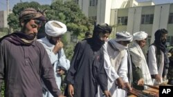 Taliban fighters hand over their weapons in Herat in September.