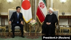 Iranian President Hassan Rohani (right) meets with Japanese Prime Minister Shinzo Abe in Tehran on June 12.