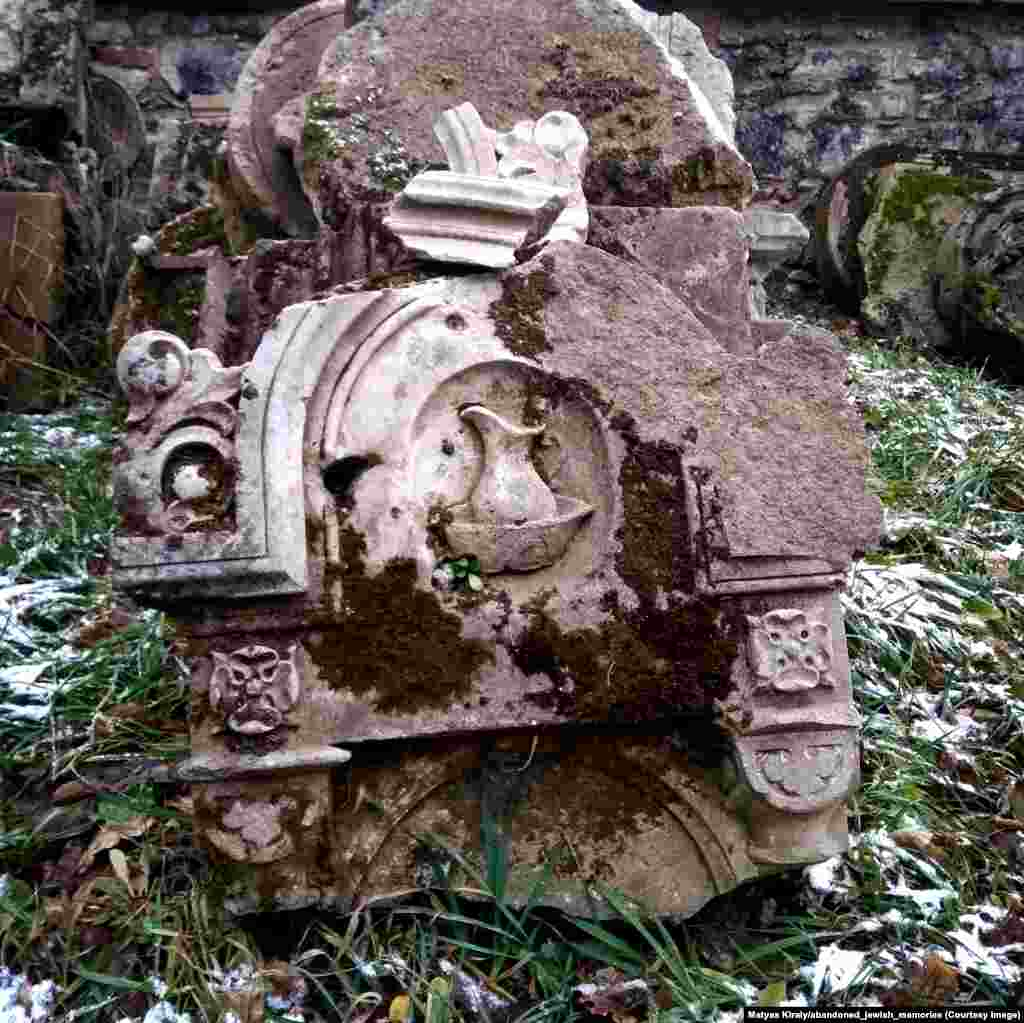 A broken tombstone in eastern Austria. The pitcher of water indicates the deceased's lineage to one of Judaism's most venerated tribes.