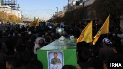 FILE: The burial procession of an Afghan fighter in Iran after he was killed in Syria.