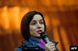 Moldovan pro-EU politician and presidential candidate Maia Sandu addressing supporters on October 24.