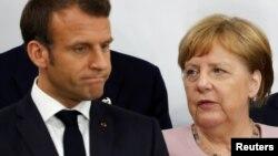 Francuski predsjednik Emmanuel Macron i njemačka kancelarka Angela Merkel tokom G20 samita u Japanu