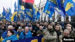 Участники марша в Киеве, организованного националистическими партиями. 22 февраля 2017 года.