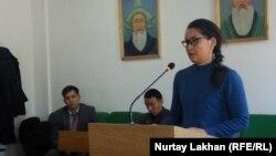 Qaisha Aqan speaks in the courtroom in Almaty in November 2019.