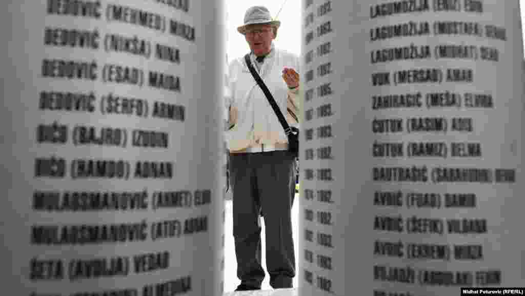 A man pays his respects at a memorial to the children who died.