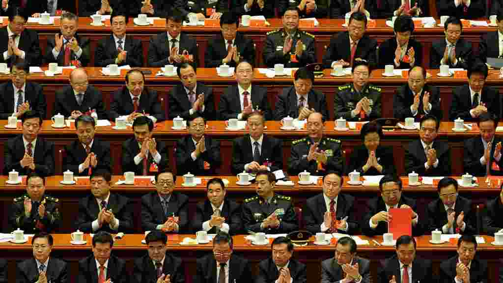 Delegates clap after a speech by outgoing Chinese President Hu Jintao during the closing ceremony of the Party Congress at the Great Hall of the People in Beijing. (AFP/Mark Ralston)