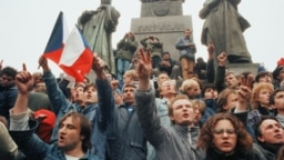 Czechoslovakia Demonstrations 1989 -- file -- Prague citizens, gathering on Wenceslas square in Prague Monday, Nov. 20, 1989 shouting and urging for more democracy and free elections. (AP Photo/Peter Dejong)