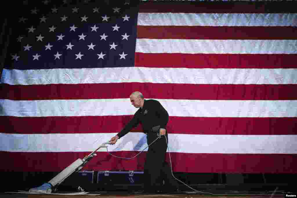 A worker cleans a stage to prepare for a victory celebration for Democratic Governor Andrew Cuomo in New York. (Reuters/Lucas Jackson)