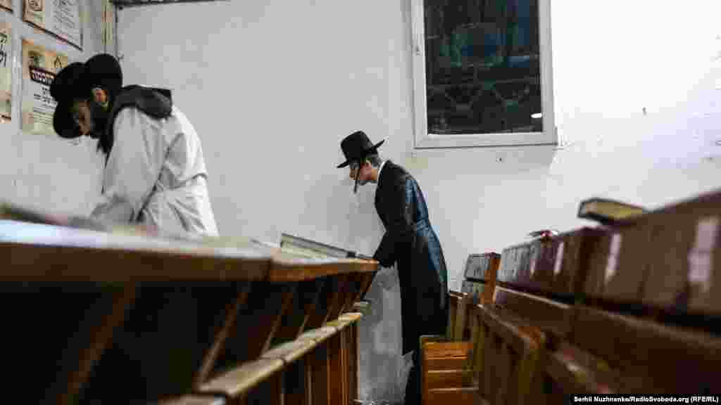 Some faithful pilgrims stay in synagogue after the evening prayers are finished.