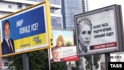 Election billboards for presidential candidates Serhiy Tihipko (left to right), Petro Poroshenko, and Yulia Tymoshenko are seen in the Ukrainian capital, Kyiv.