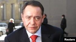 Ministrul mediilor, Mihail Lesin, la sediul ministerului său, 27 martie 2002