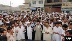 People pray for victims of the August 21 suicide attacks near Islamabad