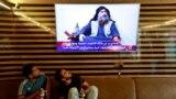 IRAQ -- Iraqi youth watch the news of Islamic State leader Abu Bakr al-Baghdadi death, in Najaf, Iraq October 27, 2019.