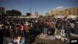 Protesters perform the Friday midday prayer on Cairo's landmark Tahrir Square.