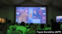 Saudi soccer fans watch World Cup festivities in Russia at a fan tent in the capital Riyadh.
