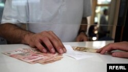The Serbian dinar has lost 30 percent of its value in the past year and a half.