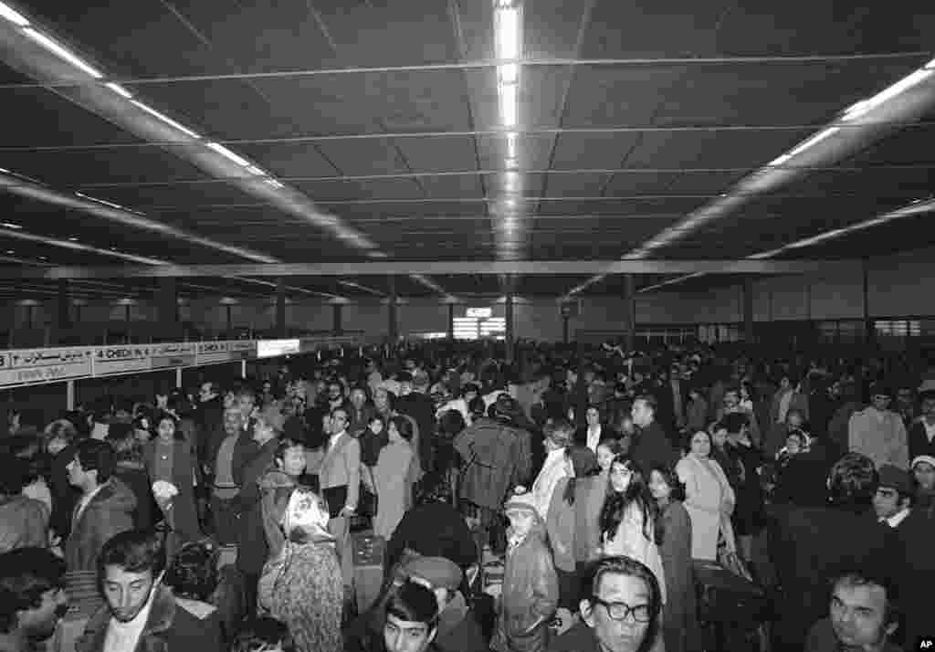 Days after the Shah's departure, hundreds of people, including many foreigners, were desperate to leave Iran. People packed into the departure hall of Tehran's Mehrabad Airport on January 25, 1979, with the hopes of catching a flight out of the country.