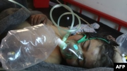 A Syrian child receives treatment after the suspected toxic gas attack in Khan Sheikhun