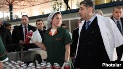 Armenia - Prime Minister Tigran Sarkisian (R) visits a beverage plant in Yerevan, 4Feb2013.