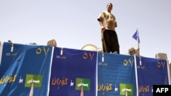 A wall draped with election posters in the northern Iraqi city of Sulaimaniyah.