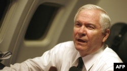 U.S. Secretary of Defense Robert Gates speaks to members of the press aboard his plane en route to Cairo.