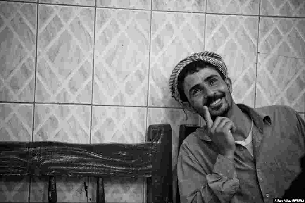 A construction worker in Kirkuk enjoys some free time in a tea house.