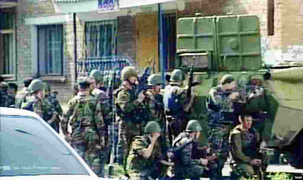 Russian troops gather outside Beslan's School No. 1.