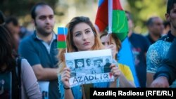 The crowd at the Baku rally held aloft Azerbaijani flags and photographs of people believed to be political prisoners.