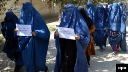 File photo of Afghan women protest against a high-profile gang rape case in 2014.