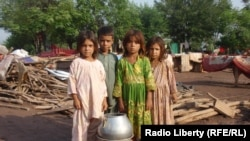 Refugee Afghan children in Pakistan. There are more than 3 million Afghan refugees living in the border regions of neighboring Iran and Pakistan.