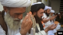 Supporters of Jamiat Nazariyati pray for late Taliban leader Mullah Muhammad Omar in Quetta, Pakistan.