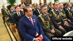 The president's son-in-law, Shamsullo Sohibov, pictured in the blue suit, controls a vast amount of wealth in Tajikistan.