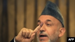 The latest preliminary results show President Hamid Karzai with 54 percent of the vote.