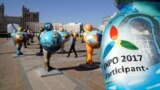 Kazakhstan -- People walk past figures symbolizing countries-participants in the Expo 2017 at downtown of Astana, host city of the next year exhibition, September 29, 2016