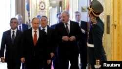 Russia -- Leaders of the Collective Security Treaty Organization (CSTO) walk during a summit at the Kremlin in Moscow, 15May2012
