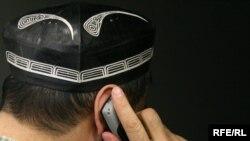 RFE/RL - A man talks on telephone - generic photo