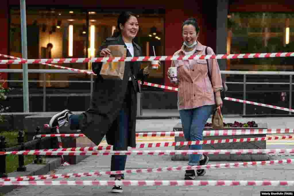 Women walk in Moscow's Novopushkinsky Square. (TASS/Valery Sharifulin)