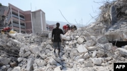 People search through rubble from the January 12, 2010 earthquake, Port au Prince