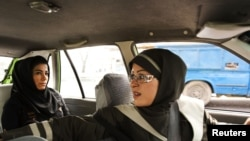 A female taxi driver fetches a passenger in Tehran, 21Aug2011