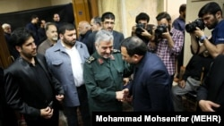IRGC Commander-in-chief Mohammadali Jafari (C) attending the funeral for the mother of former Fars news agency CEO Hamidreza Moghadamfar (R) in Tehran, on July 31, 2018.