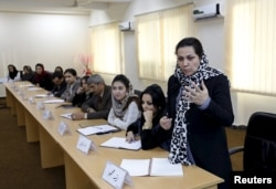 An Afghan woman speaks as they attend a class of the gender and women's studies masters program in Kabul University, October 19.
