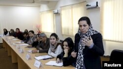 Afghanistan--An Afghan woman speaks during class on October 19, 2015
