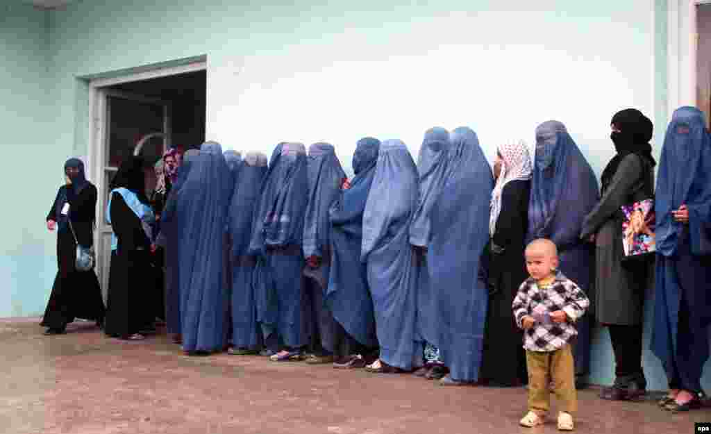 Afghan women line up to cast their ballot at a polling station during the presidential election in Takhar on April 5. (epa/Hasib Arman)