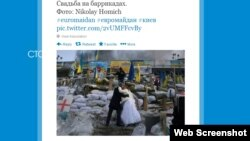 "A screen grab of a tweet showing newlyweds ""Marina"" and ""Andriy"" at Independence Square in Kyiv"
